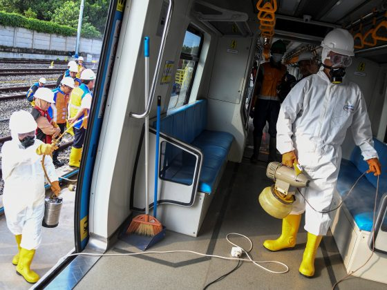 Staff in protective suits spray disinfectant on the Light Rail Transit (LRT) train after Indonesia confirmed new cases of coronavirus disease (COVID-19), in Palembang, South Sumatra, Indonesia March 10, 2020 in this photo taken by Antara Foto. Antara Foto/NovaWahyudi/ via REUTERS ATTENTION EDITORS - THIS IMAGE WAS PROVIDED BY A THIRD PARTY. MANDATORY CREDIT. INDONESIA OUT.